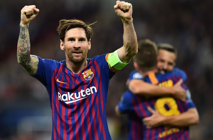 Messi scores twice as Barca hold off Spurs comeback