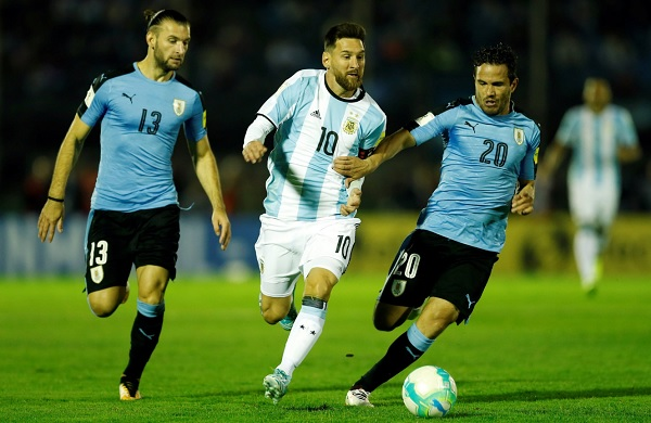 Lionel Messi runs against Uruguay